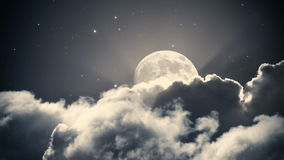 Starry night sky with clouds and full moon. Animation stock video footage