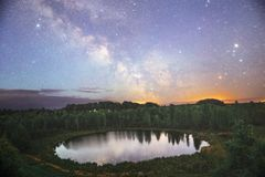Starry night sky in a forest. Near the lake royalty free stock images