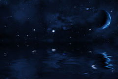 Starry night sky with halted moon over sea, bright stars and blue nebula Royalty Free Stock Photo