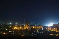 Starry night sky over the city. Starry night sky over the city Stock Image