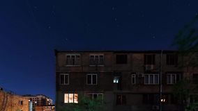 Starry night sky over houses in Yerevan Armenia stock footage