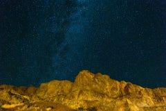Starry Night Sky over Rocky Landscape at night Royalty Free Stock Photography