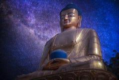 Starry night sky. Golden Buddha in Kathmandu Stock Photo