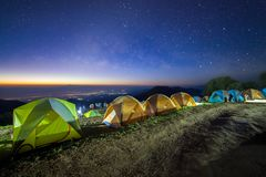 Starry night sky with tent at Monson viewpoint Doi AngKhang and. Milky way galaxy with stars and space dust in the universe royalty free stock photography