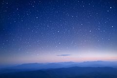 Starry in the night sky use as wallpaper royalty free stock photo