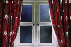 Starry night sky through a window Royalty Free Stock Photo