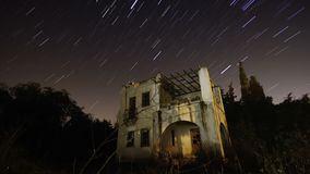 Starry night under the abandoned house stock video footage
