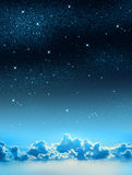 Starry Sky. Beautiful starry sky background with some clouds Stock Photo