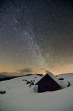 Starry sky above abandoned huts in the mountains stock photo