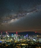 Starry sky above glowing city in night royalty free stock photos