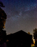 Starry sky above house. In countryside Royalty Free Stock Photo