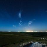 Starry sky above the lighted lanterns city. Stock Photography