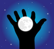 Starry sky hand holding up the moon Stock Images
