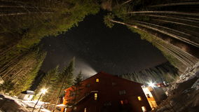 Starry sky and a house in the mountains among the trees. Time Lapse. stock video