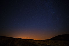 Starry sky and Milky Way  above the lighted lanterns city. Royalty Free Stock Images