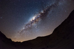 Starry sky and Milky Way arc, with details of its colorful core, outstandingly bright, captured from the Namib desert in Namibia,. Africa. The Small Magellanic Royalty Free Stock Image