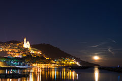 Starry sky and moonlight at glowing Cervo, Ligurian Riviera, Italy Royalty Free Stock Images