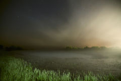 Starry sky, night photography, astrophotography, fog over the lake Stock Photos