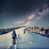 Starry sky at night in the winter snow. Milky Way Stock Photography