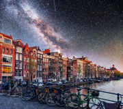 Starry sky over Amsterdam. Street bikes on the bridge Stock Photography