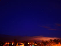 Starry sky over the city. Royalty Free Stock Photos