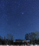 Starry sky over a country house Royalty Free Stock Photo