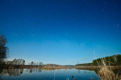Starry sky over the lake Stock Image