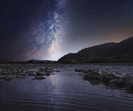 Starry sky over mountain river Royalty Free Stock Images