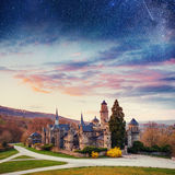 Starry sky over the old ancient castle Stock Images