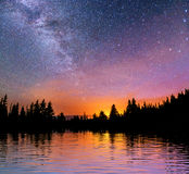Starry sky over the sea. Fantastic Milky Way. Meteor shower Royalty Free Stock Photography