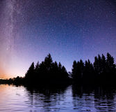 Starry sky over the sea. Fantastic Milky Way. Meteor shower Royalty Free Stock Images