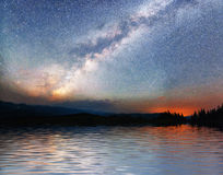Starry sky over the sea. Fantastic Milky Way. Meteor shower. Carpathians. Ukraine, Europe Royalty Free Stock Photography