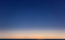 Starry Sky and the Sicily Coastline. Sicily as seen on the horizon from Malta, on a clear and starry night stock photography