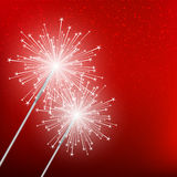 Starry sparklers. On red background Royalty Free Stock Images