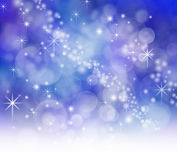 Starry Sparkly Bokeh background. Starry night effect blue background with sparkles and bokeh Stock Images