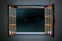 Starry Window. Room window wide open to a calm and clear starry night sky Stock Image