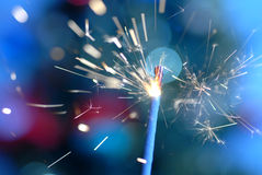 Stars. From a burning sparkler with blue blur background Stock Image