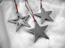 Stars. Pretty silver star ornaments with red ribbons Royalty Free Stock Photography