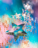 Stars Abstract. Tiny sequin stars resting on a mirror with glitter Stock Images