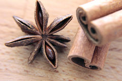 Stars anise,  cinnamon stick on wood background Royalty Free Stock Photos