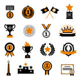 Stars And Awards Decorative Icons Set. Stars and awards flat decorative icons set with cup crown medals and sport  rewards in black and gold colors isolated Stock Images