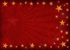 Stars background. Golden stars on a grunge red background Royalty Free Stock Image