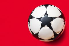 Stars ball. White ball with black stars on a red background Stock Photos