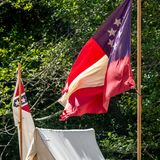 American Civil War confederate flag. Stars and Bars confederate flag on the side of a canvas tent suggesting a civil war confederate camp Royalty Free Stock Images