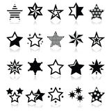 Stars black icons with reflection isolated on white. Winter Christmas icons set- stars and sparkles Royalty Free Stock Images