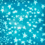 Stars on blue crumpled paper Royalty Free Stock Images