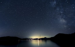 Stars and boats. At night in Aegean Sea royalty free stock photos