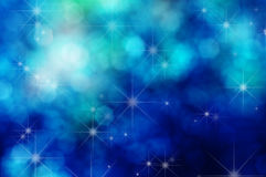 Stars and Bokeh Background. A twinkly sky or space background with white scattered stars and bokeh in dark blue and turquoise Royalty Free Stock Images