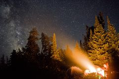 Stars, campfire, and friends. stock photography