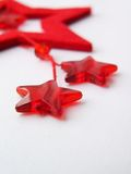Stars. Christmas decorations. Two red stars on a gray background - christmas decorations Royalty Free Stock Photo